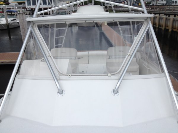 An Express Cruiser is one with an open cockpit. It has a full head, a galley, sleeping space. There are large open areas near the helm. It