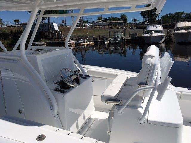 The definition of an outboard motor is a detachable engine mounted on outboard brackets on the stern of your boat.  This configuration will have twin engines.