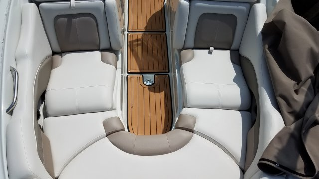 Glass fibers either loose or woven, reinforced with resin and used in the construction of many boats.